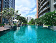 Relax after surgery beside AETAS Residence outdoor swimming pool with whirlpool